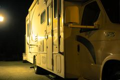 recreational vehicle night side - stock photo