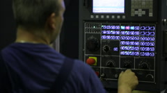 Industrial Machine Operator. Male worker using industrial control panel of a Stock Footage