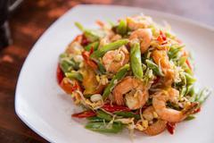 Stir-fry prawn with bean on square white plate Stock Photos