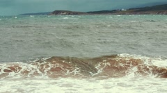 Slow motion shot of a gorgeous beach and the rough ocean water Stock Footage