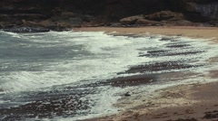 Slow motion shot of gorgeous beach and rough ocean water Stock Footage