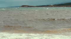 Slow motion shot of the gorgeous beach and the rough ocean water Stock Footage