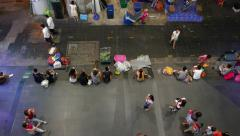 People rest sitting at sideway street hawkers prepare evening marketing top view Stock Footage