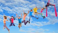 happy dancing jumping children in sky - stock photo