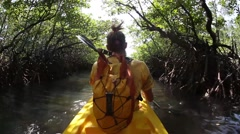 Young lady paddling hard  the sea kayak with lots of splashes Stock Footage