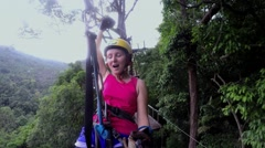 Woman Going on a Jungle Zip Line Adventure Stock Footage
