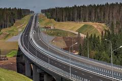 New modern steel motor road bridge on reinforced concrete supports. - stock photo