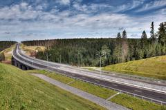Speedway roadside storm drain ditch, stormwater drainage, Russian countryside - stock photo