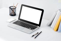 Stock Photo of laptop, mobilephone and stationery on desk