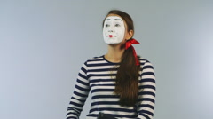 Woman mime with a tablet gadget Stock Footage