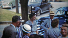 1951: Community members gather and leave outside of church. Stock Footage