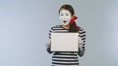 Woman mime shows a frame with markers for tracking Stock Footage