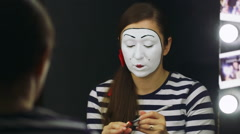 Portrait of the girl mime, which causes his stage makeup Stock Footage