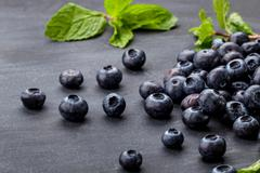 Stock Photo of fresh blueberries on black board for background