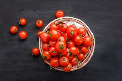 Pile of cherry tomatoes in a rattan basket Stock Photos