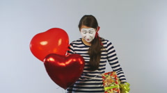 Cheerful girl mime with balls and gifts. Concept: Holidays Shopping Stock Footage