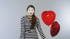 Cheerful girl mime with balls and gifts. Concept: Holidays Shopping - stock footage