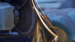 Grinder grinding bolt in slow motion throwing sparks Stock Footage