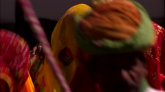Holi Festival India women dancing in saris Stock Footage