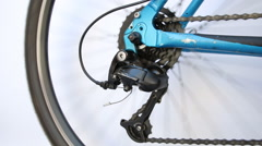 Derailleur and cassette on a  bike in motion, white background Stock Footage