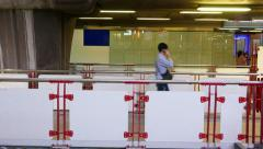 Pedestrian skywalk on foreground and background, several people pass, evening Stock Footage