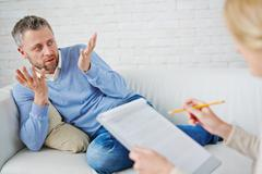 Talking to psychologist Stock Photos