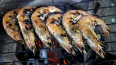 Grilled shrimps on the flaming grill Stock Footage