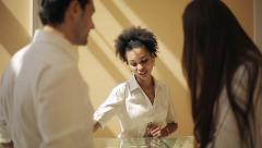 Jewelry store: African american female seller and caucasian loving couple Stock Footage
