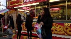 Mini donuts booth at Coast Amusements Carnival Stock Footage