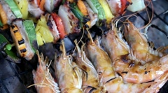 Grilled meat, shrimps and vegetables Stock Footage