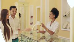 Jewelry store: African american female seller and caucasian loving couple - stock footage