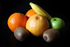 Various fruits isolated on the black background Stock Photos