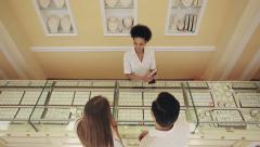 Jewelry store: African american seller and caucasian loving couple buyers Stock Footage