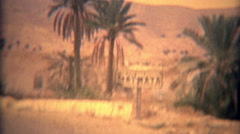 1975: Driving into Matmata Arab desert landscape riding mule. Stock Footage