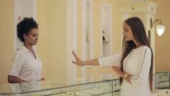 Jewelry store: Young woman tries on expensive bracelet - stock footage