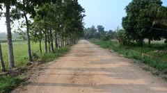 Lateritic road at countryside Stock Footage