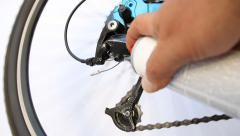 Bicycle chain and derailleur being sprayed with a lubricant Stock Footage