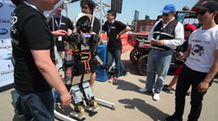 DARPA Robotics Challenge THOR Team Posing with Robot Stock Footage