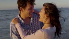 Young Woman Surprises Boyfriend, They Kiss, Walk Off into Sunset Togethe Stock Footage