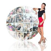 Stock Photo of Woman stands beside collage sphere