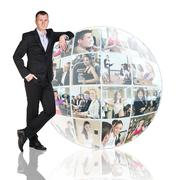 Man stands beside collage sphere - stock photo
