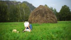 Girl read book on the grass.mp4 Stock Footage