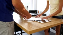 Man and woman arguing about some documents. Close-up - stock footage