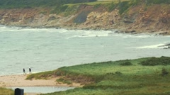 Slow motion shot of a sandy beach rain and the rough ocean water Stock Footage