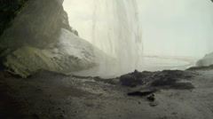 Behind the waterfall Seljalandsfoss in Iceland, wintertime Stock Footage