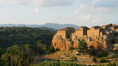 Medieval town of Pitigliano on the cliff at sunset, Tuscany, Italy Stock Footage