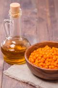Sea-buckthorn oil and berries - stock photo