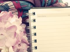 blank note book and flower vintage style filters - stock photo