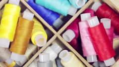 Multicolored sewing threads in a box Stock Footage