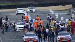 Racers occupy starting positions Stock Footage